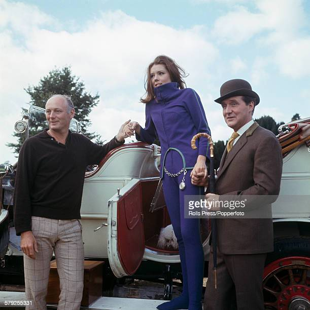 English actors Diana Rigg and Patrick Macnee both dressed in character as Emma Peel and John Steed from the television series The Avengers pictured...