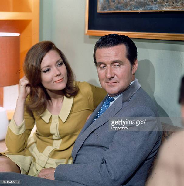 English actors Diana Rigg as 'Emma Peel' and Patrick Macnee as 'John Steed' pictured during the filming of the television series 'The Avengers' in...