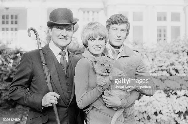 English actors Patrick Macnee Joanna Lumley and Gareth Hunt posed together at a press reception to launch the television series The New Avengers at...