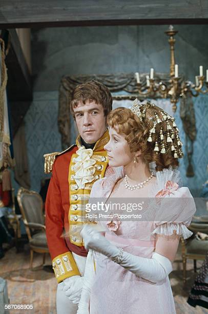 English actors Susan Hampshire and Bryan Marshall pictured together wearing period costume in character as Becky Sharp and Captain Dobbin on the set...