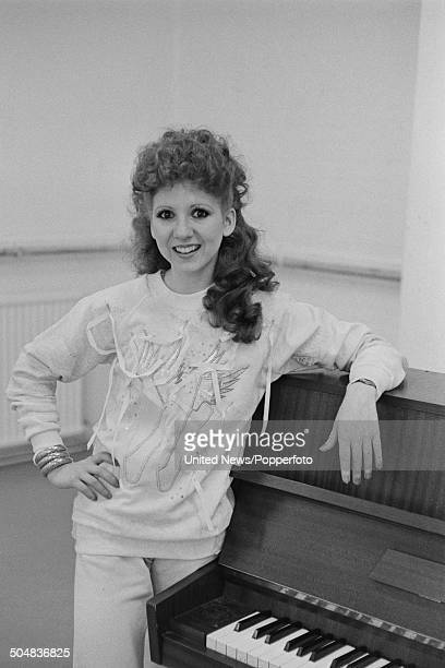 English actress and dancer Bonnie Langford posed beside a piano in London on 2nd August1984