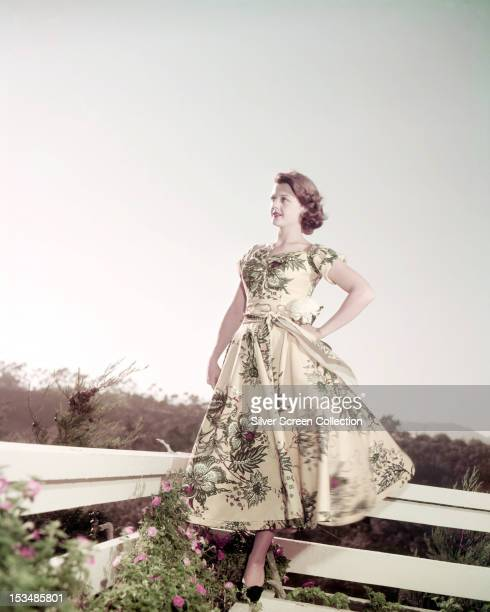 English actress Angela Lansbury wearing a long floralpatterned dress circa 1945