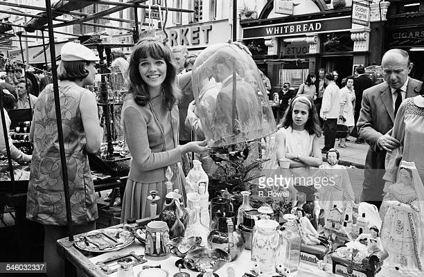 English actress Annette Day at her mothers stall in Portobello Road London July 1967 Annette has been spotted whilst working on the stall by an...