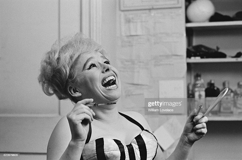 English actress <a gi-track='captionPersonalityLinkClicked' href=/galleries/search?phrase=Barbara+Windsor&family=editorial&specificpeople=210539 ng-click='$event.stopPropagation()'>Barbara Windsor</a> in her dressing room preparing for her part in 'Oh! What a Lovely War' at the Broadhurst Theatre, Broadway, New York City, 6th November 1964.