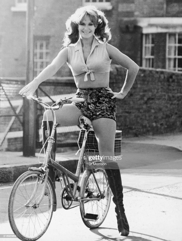 English actress Carol Cleveland cycling in hot pants November 1971