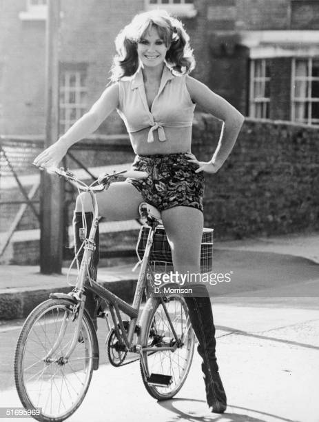 English actress Carol Cleveland cycling in hot pants November 1971