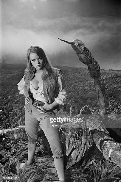 English actress Dana Gillespie poses with a giant scorpion on the set of the Hammer film 'The Lost Continent' based on the novel 'Uncharted Seas' by...