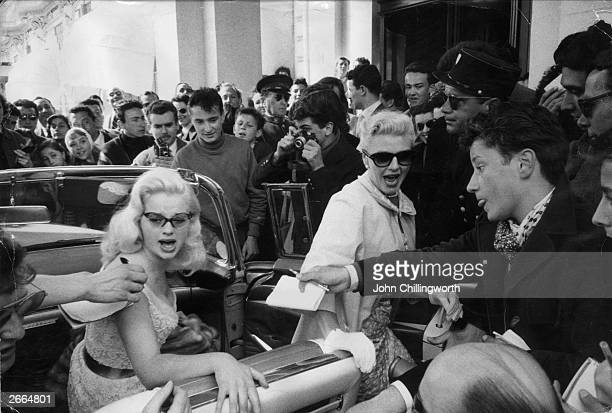 English actress Diana Dors and Ginger Rogers are mobbed by fans at the Cannes International Film Festival France Original Publication Picture Post...