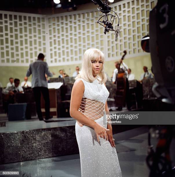 English actress Diana Dors pictured on the television series 'The Dickie Valentine Show' in 1966