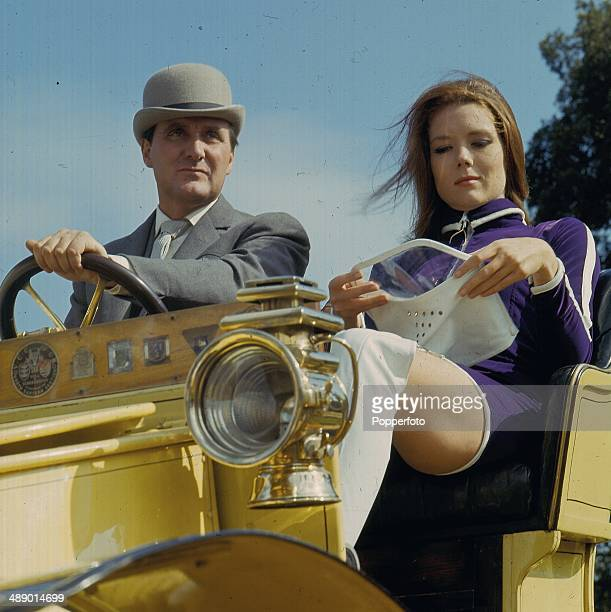 1967 English actress Diana Rigg and English actor Patrick Macnee as 'Emma Peel' and 'John Steed' in a vintage car on the set of the television series...