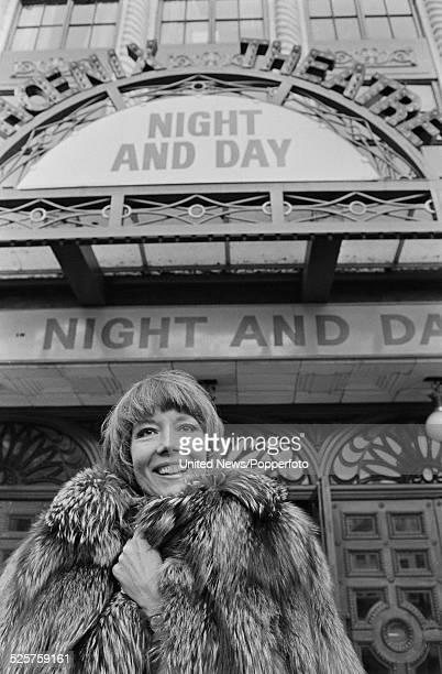 English actress Diana Rigg stands outside the Phoenix Theatre in London during a West End run of the Tom Stoppard play Night and Day on 19th March...