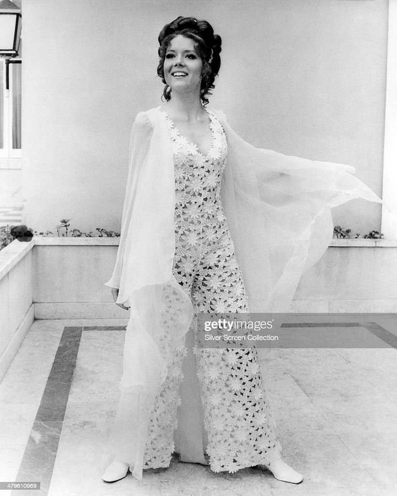 English actress <a gi-track='captionPersonalityLinkClicked' href=/galleries/search?phrase=Diana+Rigg&family=editorial&specificpeople=206289 ng-click='$event.stopPropagation()'>Diana Rigg</a> wearing a lace outfit in a promotional portrait for 'On Her Majesty's Secret Service', directed by Peter R. Hunt, 1969. Rigg plays Contessa Teresa di Vicenzo/Tracy Bond in the film.