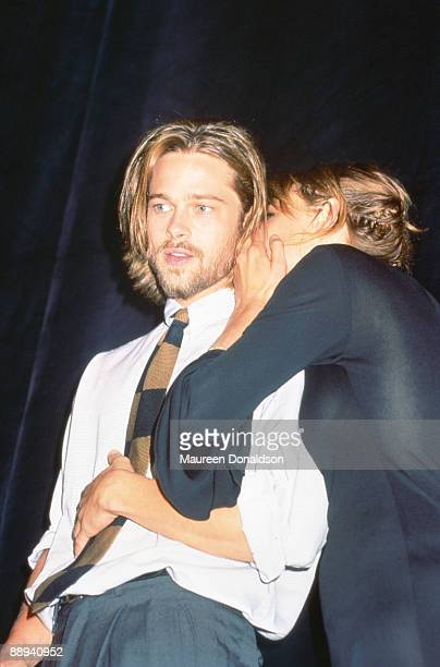 English actress Emily Lloyd whispers in the ear of American actor Brad Pitt during the Toronto Film Festival September 1992 They are there for the...