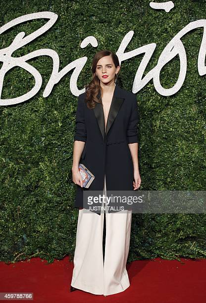 English actress Emma Watson poses for pictures on the red carpet upon arrival to attend the British Fashion Awards 2014 in London on December 1 2014...