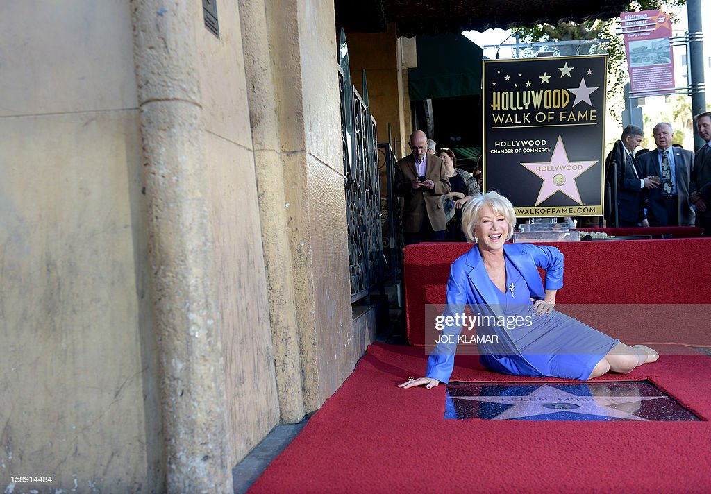 English actress Helen Mirren is honored on The Hollywood Walk Of Fame with a star on January 3, 2013 in Hollywood, California. Dame Helen Lydia Mirren, DBE, has won an Academy Award, four BAFTAs, three Golden Globes, four Emmy Awards, and two Cannes Film Festival Best Actress Awards. AFP PHOTO / JOE KLAMAR
