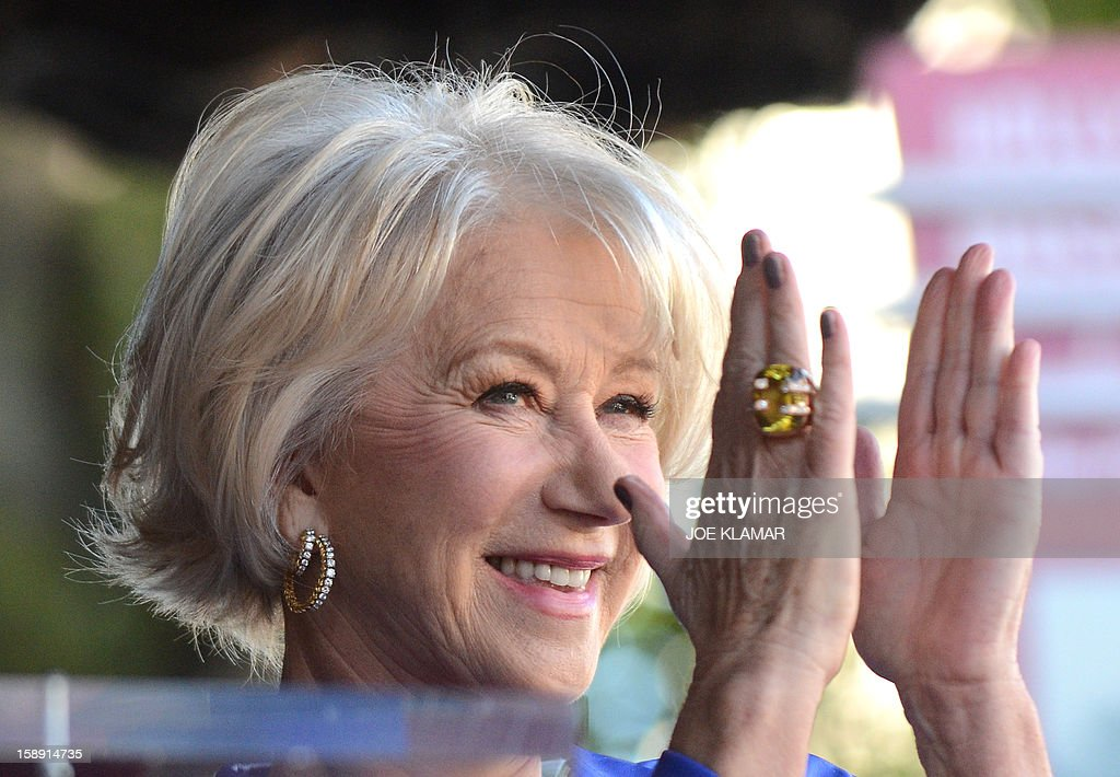 English actress Helen Mirren is honored on The Hollywood Walk Of Fame with a star on January 3, 2013 in Hollywood, California.Dame Helen Lydia Mirren, DBE has won an Academy Award, four BAFTAs, three Golden Globes, four Emmy Awards, and two Cannes Film Festival Best Actress Awards. AFP PHOTO / JOE KLAMAR