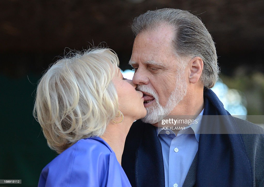 English actress Helen Mirren kisses with her husband director Taylor Hackford as she is honored on The Hollywood Walk Of Fame with a star on January 3, 2013 in Hollywood, California. Dame Helen Lydia Mirren, DBE has won an Academy Award, four BAFTAs, three Golden Globes, four Emmy Awards, and two Cannes Film Festival Best Actress Awards. AFP PHOTO / JOE KLAMAR