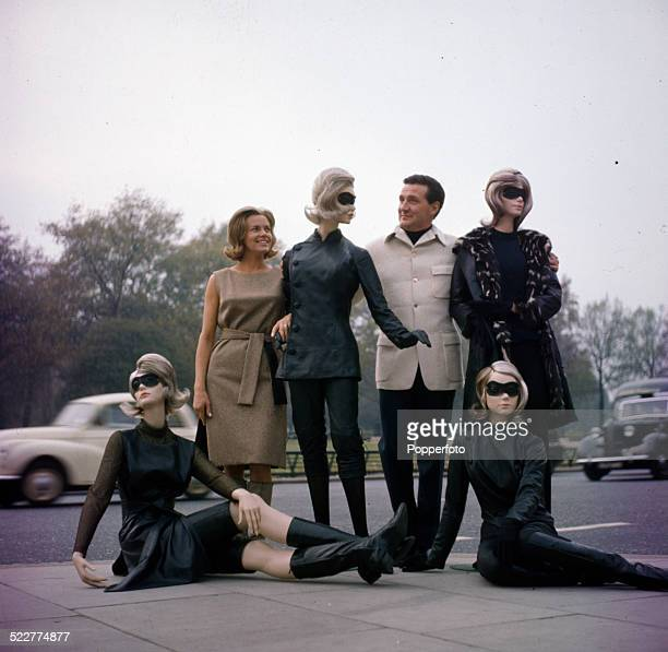 English actress Honor Blackman and English actor Patrick Macnee pictured together with various leather clad mannequins promoting the television...