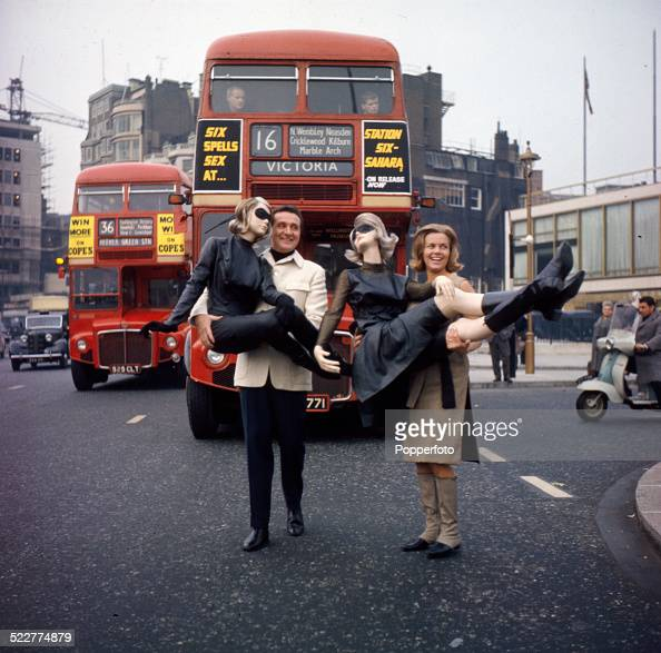 English actress Honor Blackman and English actor Patrick Macnee posed together holding mannequins to promote the television series 'The Avengers' in...