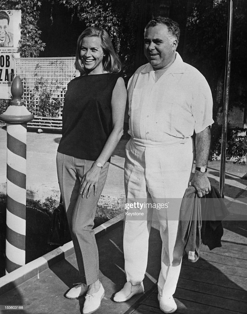English actress Honor Blackman with producer Harry Saltzman (1915 - 1994) at the 26th International Film Festival in Venice, Italy, 7th September 1965. Saltzman produced the James Bond film 'Goldfinger' the year before, in which Blackman played pilot Pussy Galore.