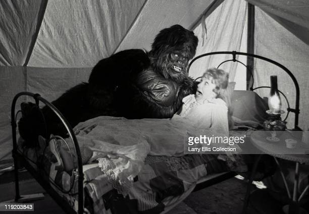 English actress Jacki Piper as June and actor Reuben Martin as the gorilla in a scene from the film 'Carry On Up The Jungle' 1970