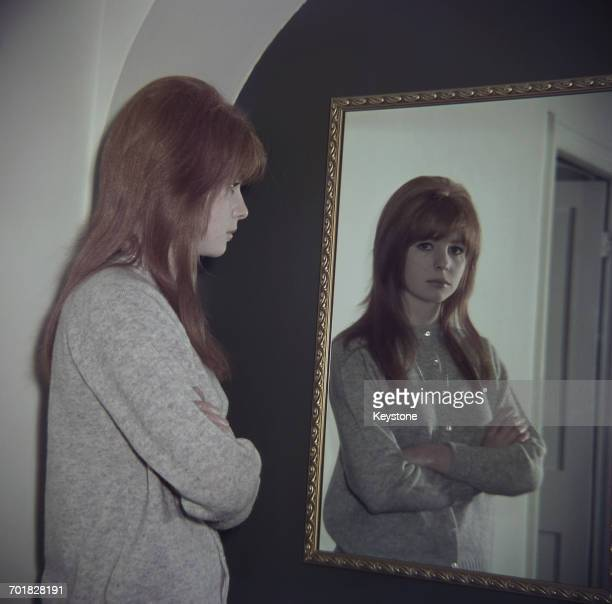English actress Jane Asher reflected in a mirror 1964
