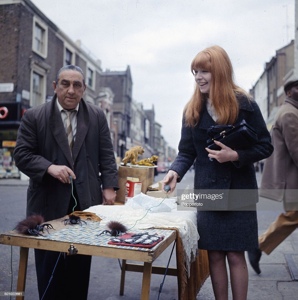 English actress Jane Asher visits a street market stall in London in 1966.