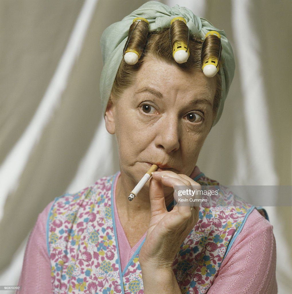 English actress Jean Alexander reprises her role as Hilda Ogden in the television soap opera 'Coronation Street', circa 1990.