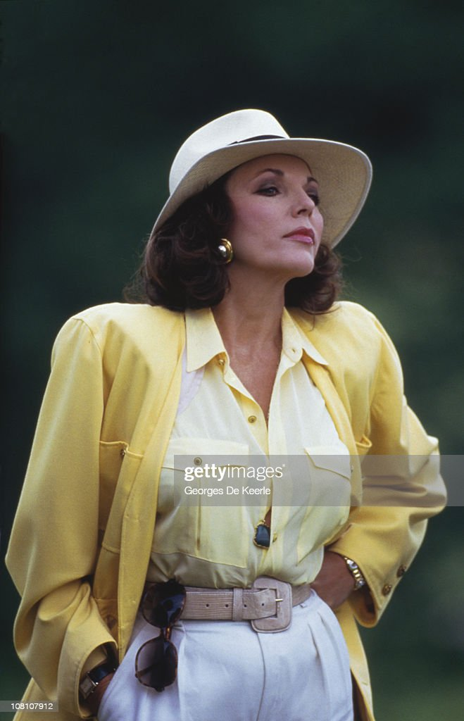 English actress Joan Collins at a golf tournament in the UK, 30th May 1987.