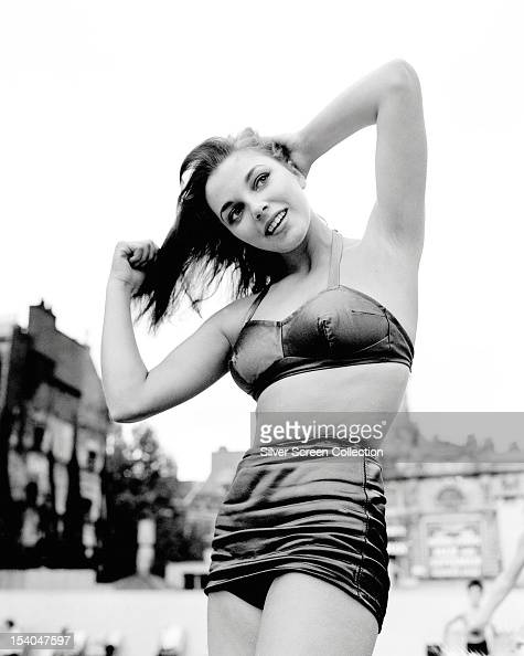 English actress Joan Collins in a twopiece swimming costume circa 1955
