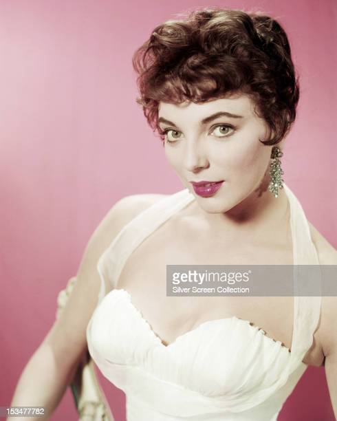 English actress Joan Collins in a white evening dress circa 1955