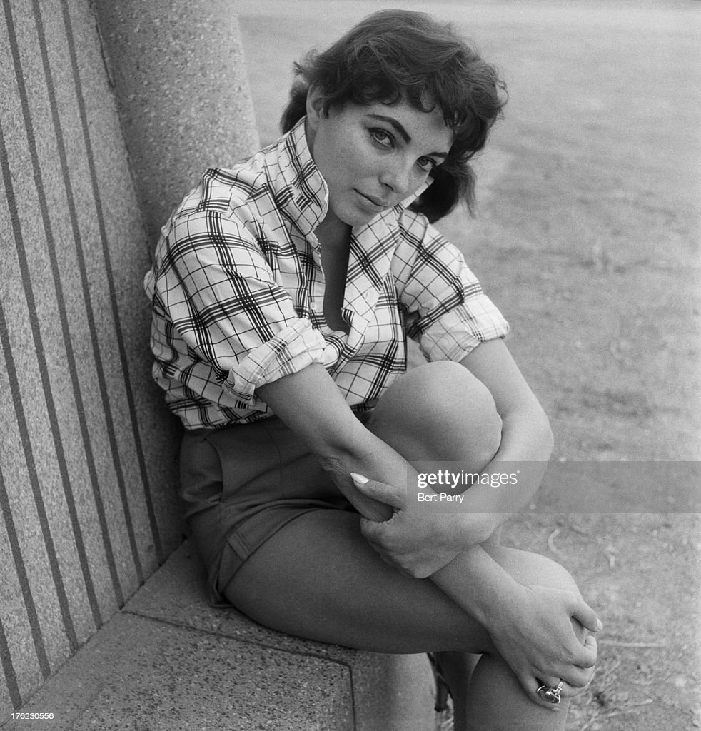 English actress Joan Collins takes a break from filming at the studio to pose for a photograph 15th August 1955