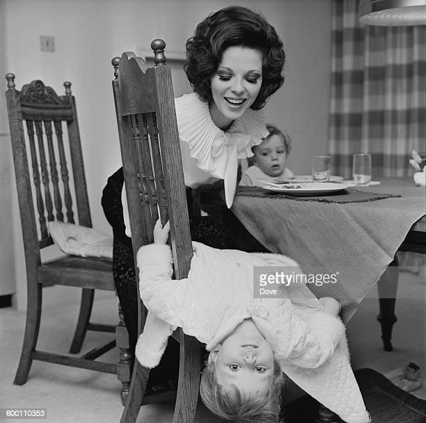 English actress Joan Collins the wife of actor and singer Anthony Newley with their two children Tara and Sacha UK 18th November 1967