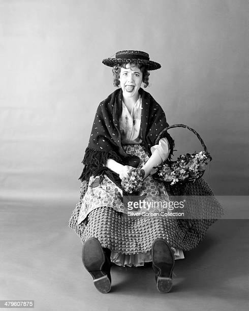 English actress Julie Andrews as the flower seller Eliza Doolittle in a promotional portrait for 'My Fair Lady' directed by George Cukor 1964