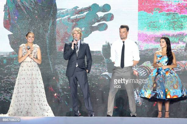 English actress Laura Haddock American director Michael Bay American actor Josh Duhamel American actress and singer Isabela Moner attend the premiere...