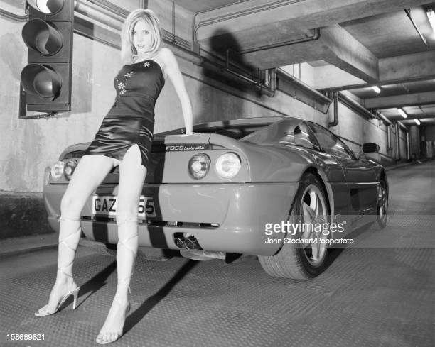 English actress Lisa Faulkner poses with a Ferrari F355 Berlinetta in 1996