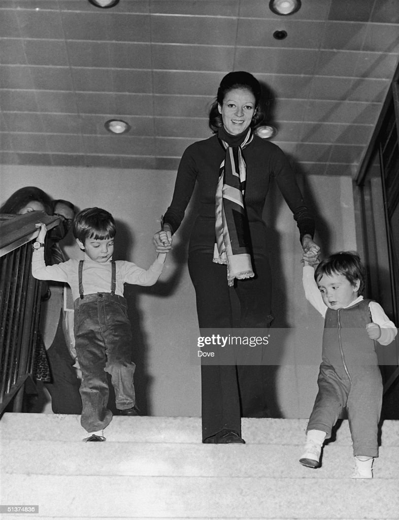 English actress <a gi-track='captionPersonalityLinkClicked' href=/galleries/search?phrase=Maggie+Smith&family=editorial&specificpeople=206821 ng-click='$event.stopPropagation()'>Maggie Smith</a> with her two children, Chris Larkin (left) and Toby Stephens, at London Airport, March 1971.