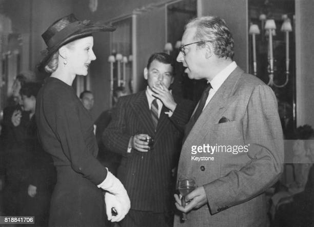 English actress Margaret Leighton chatting to director Sir Alexander Korda during a press reception at the Dorchester Hotel London UK 24th July 1947...