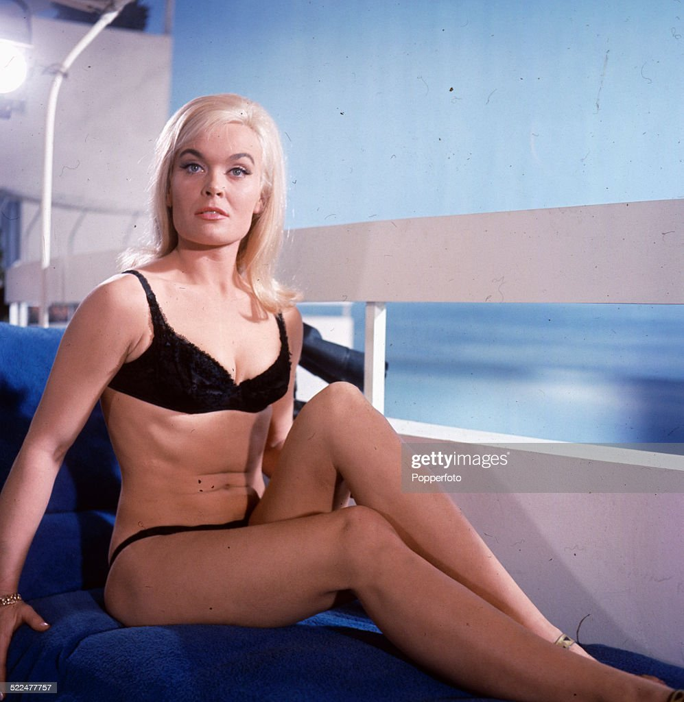 English actress <a gi-track='captionPersonalityLinkClicked' href=/galleries/search?phrase=Shirley+Eaton&family=editorial&specificpeople=900615 ng-click='$event.stopPropagation()'>Shirley Eaton</a> posed wearing black underwear on the set of the James Bond film 'Goldfinger' at Pinewood Studios in England in 1964.