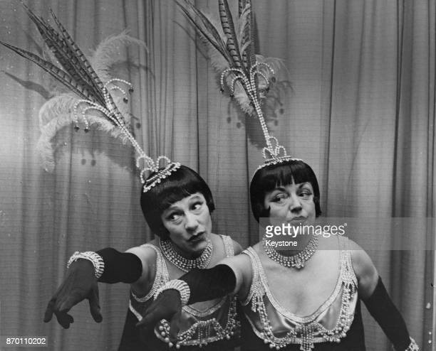 English actress sisters Angela and Hermione Baddeley in their costumes as the Dolly Sisters whom they will impersonate at the next day's charity show...