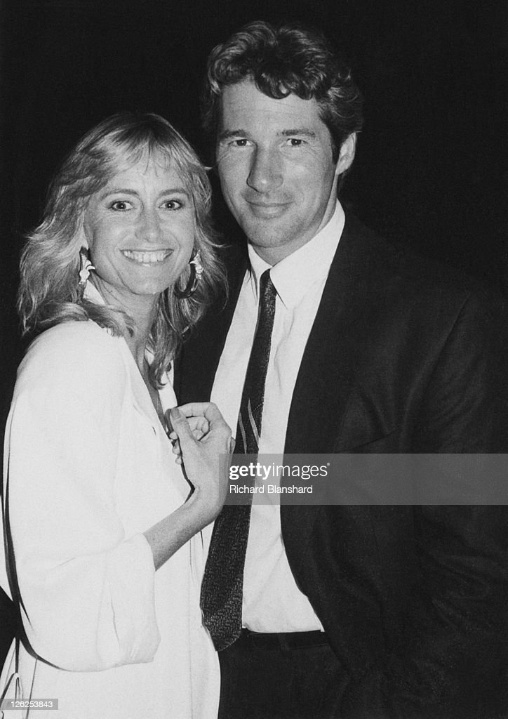 English actress Susan George poses with American actor Richard Gere, probably at the Cannes Film Festival in France, circa 1988.