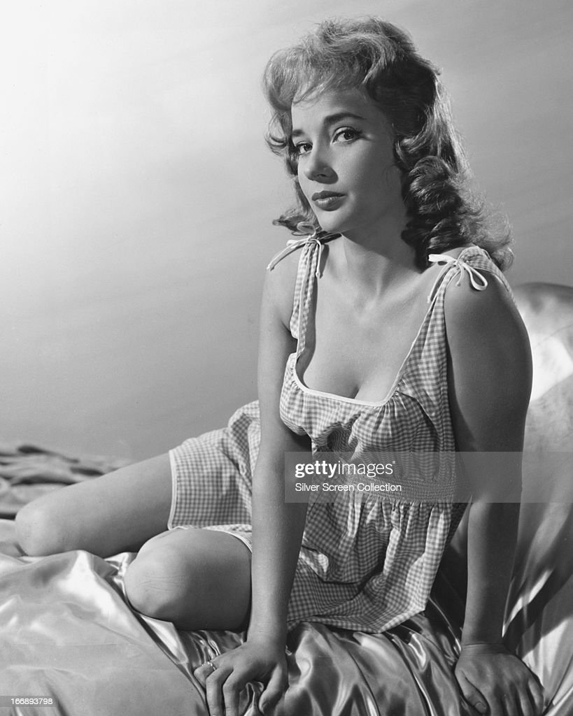 English actress <a gi-track='captionPersonalityLinkClicked' href=/galleries/search?phrase=Sylvia+Syms&family=editorial&specificpeople=235776 ng-click='$event.stopPropagation()'>Sylvia Syms</a> in a gingham nightdress, circa 1960.