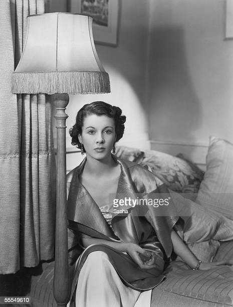 English actress Vivien Leigh relaxes against a heap of cushions 25th January 1935