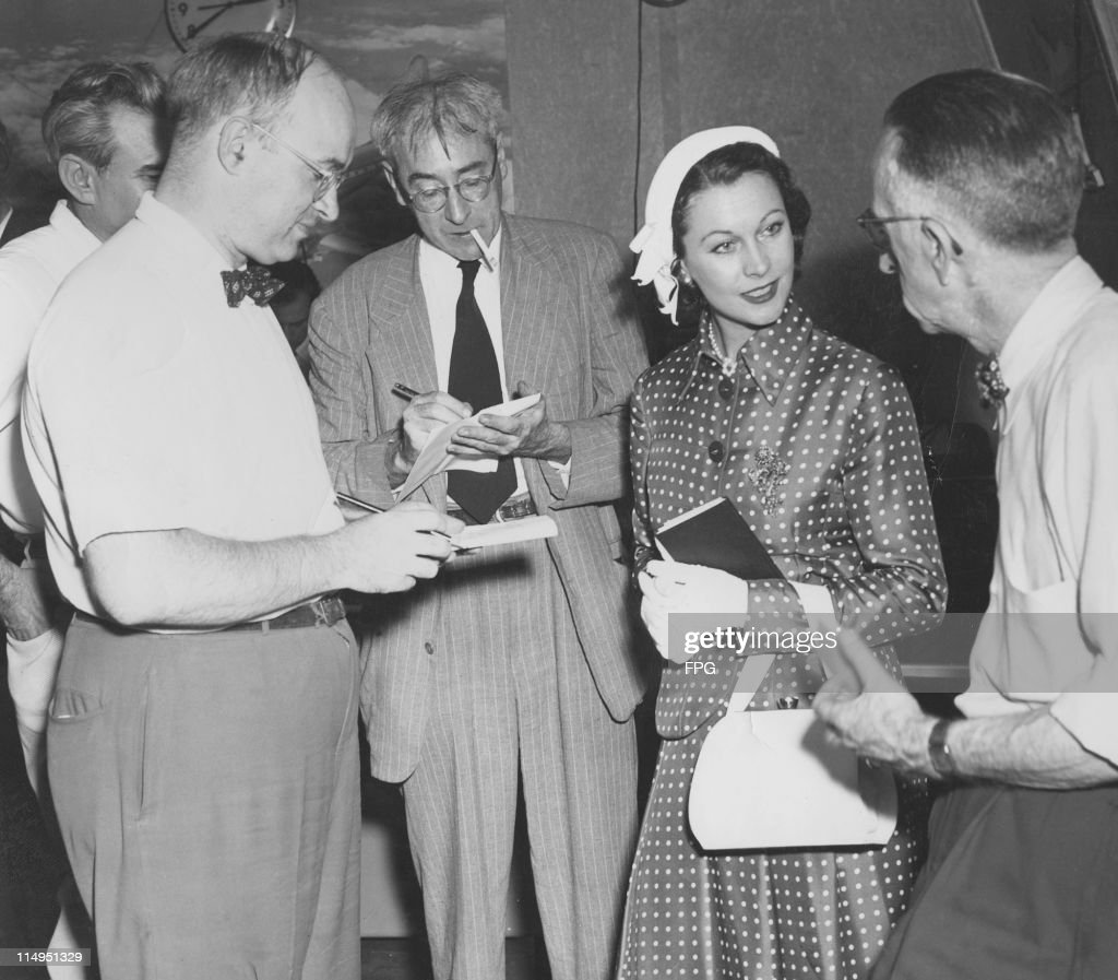 English actress Vivien Leigh (1913 - 1967) with reporters in New York, 1951. Leigh is on her way to Hollywood to film 'A Streetcar Named Desire' with director Elia Kazan.