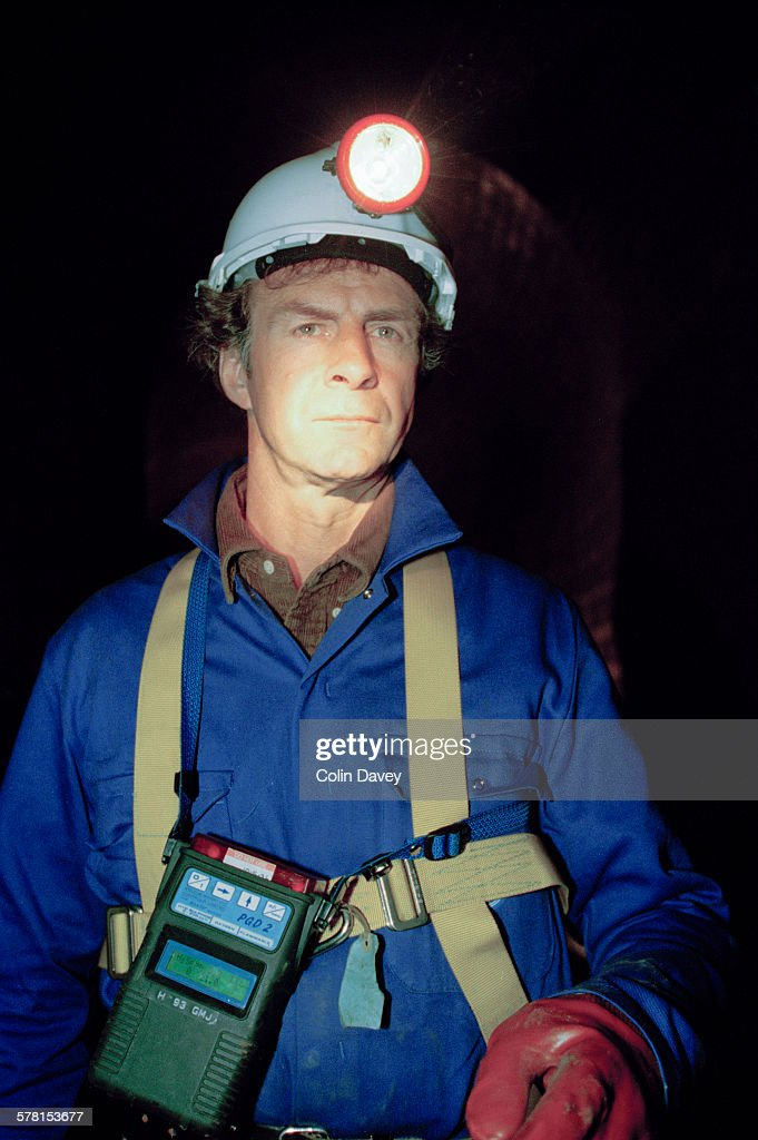 English adventurer and explorer Sir <a gi-track='captionPersonalityLinkClicked' href=/galleries/search?phrase=Ranulph+Fiennes&family=editorial&specificpeople=235354 ng-click='$event.stopPropagation()'>Ranulph Fiennes</a> explores a sewer in London, UK, 1st May 1996. He is carrying a PGD2 Mentor Portable Multi Gas Detector.