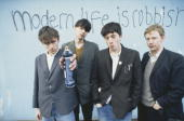 English alternative rock band Blur pose in front of the graffiti slogan 'Modern Life is Rubbish' the title of their 1993 album From left to right...