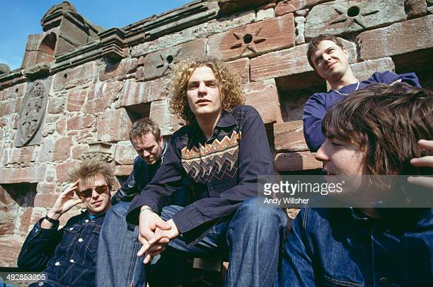 English alternative rock group Toploader circa 2000 Left to right drummer Rob Green bassist Matt Knight singer Joseph Washbourn guitarist Julian...