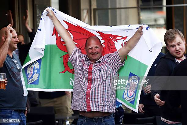 English and Welsh fans chant and drink outside a pub as they gather ahead of the England v Wales game Thursday on June 14 2016 in Lille France...