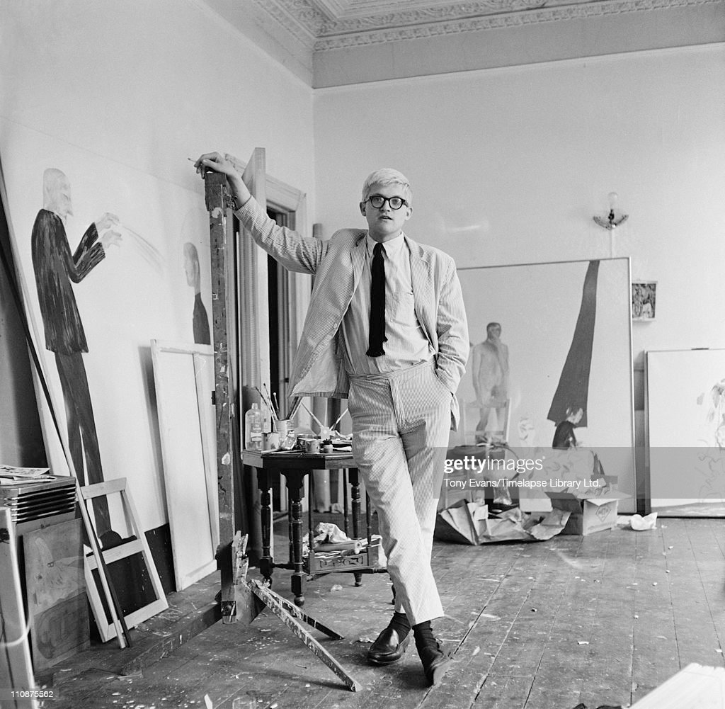 English artist <a gi-track='captionPersonalityLinkClicked' href=/galleries/search?phrase=David+Hockney&family=editorial&specificpeople=215305 ng-click='$event.stopPropagation()'>David Hockney</a> in a studio with some of his work, circa 1967.