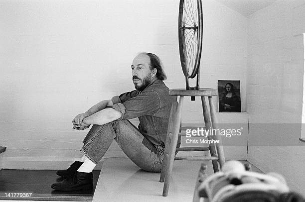 English artist Richard Hamilton posed with a replica of Marcel Duchamp's 'Bicycle Wheel' 1913 made by Hamilton in 1963 and signed on the top by...